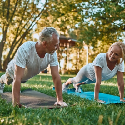 Senior,Couple,Is,Doing,Sport,Outdoors.,Stretching,In,Park,During