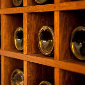 Wine,Bottles,Rack.,Wooden,Wine,Rack,In,The,French,Restaurant